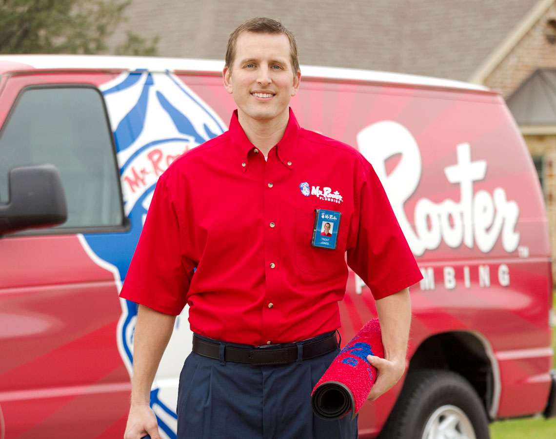 a Mr. Rooter plumber walking up to a house