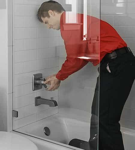 Mr. Rooter plumber fixing a shower