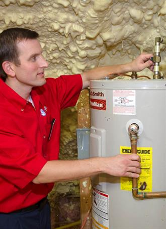 Mr. Rooter plumber fixing hot water heater
