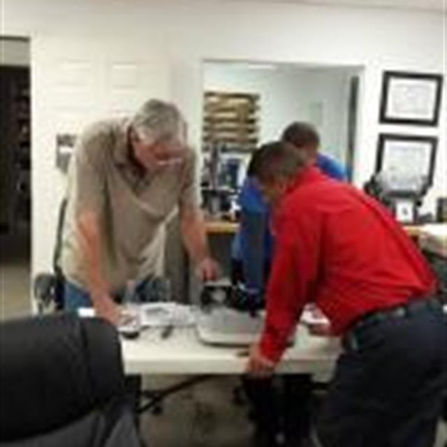Our owner and some of our technicians going through hands on training for Hague Water Treatment Systems.