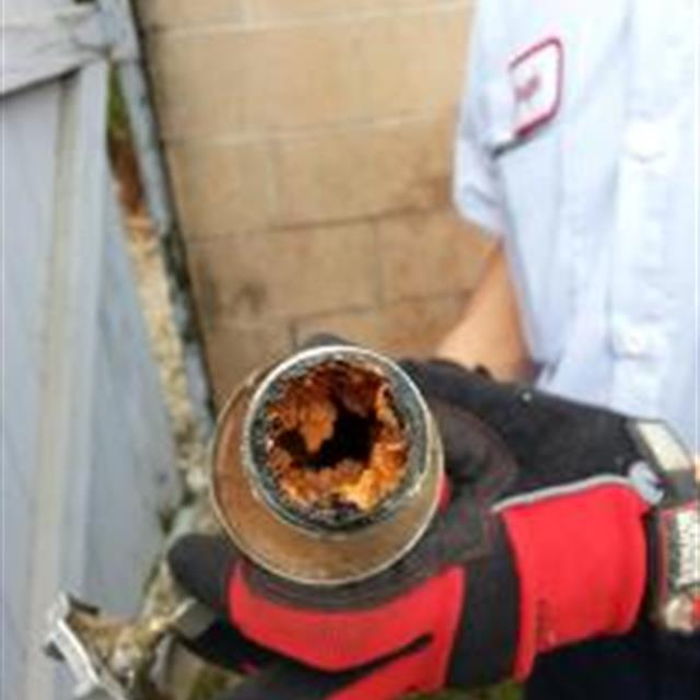A corrosion of a pipe can be caused by many different elements such as chemicals in water and weather ( heat and cold). So if your water pipes have a slow flow