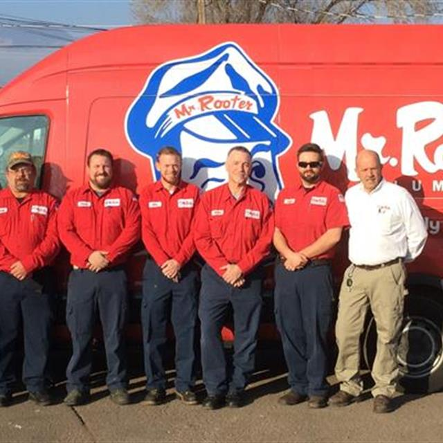 The Mr. Rooter Plumbing of Colorado Springs Team in front of the van.