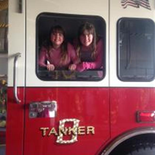 Theresa and Hailey having fun with friends at a local Fire Department.