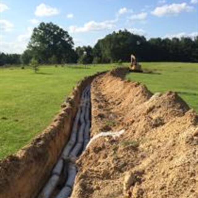 grass lawn with pipes being installed underground