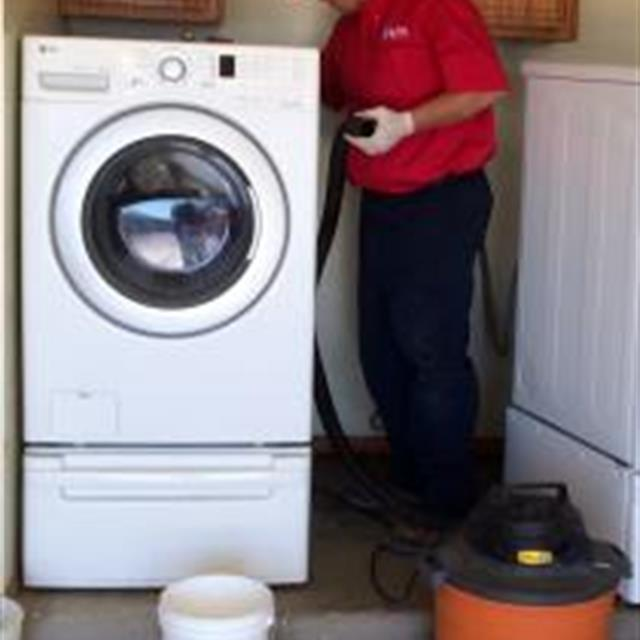 After cleaning our customers drain line. Ed goes ahead and cleans out the lint behind the washer and dryer.