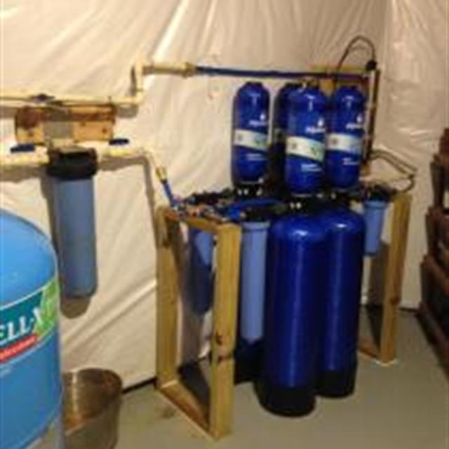 This is a complete installation of a dual Aquasana whole house water filtration system.