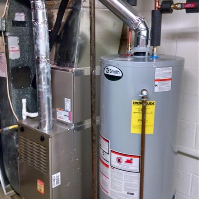 Properly installed water heater with expansion tank, drain pan piped to  floor drain, updated gas valve and new venting. Previous water heater leaked  causing thousands of dollars in  damages after only 6 years due to cheap installation using braided hoses, no  expansion tank and no piping from drain pan to drain.
