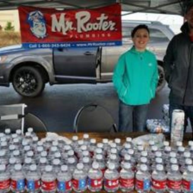 Mr. Rooter team handing out water to all the  awesome runners and walkers at the 2014 event.
