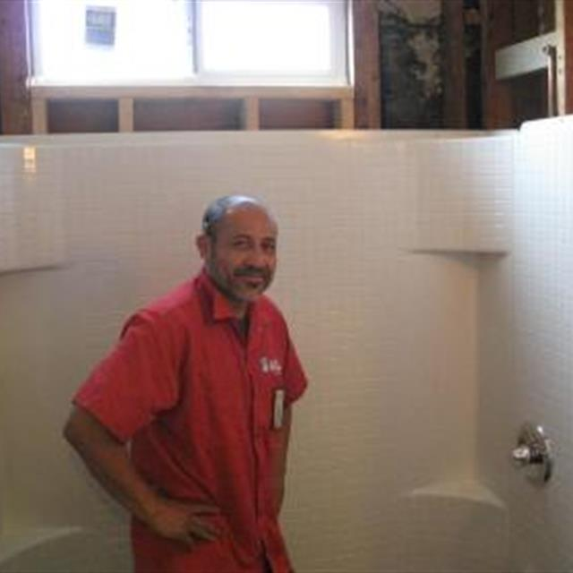 Juan, our lead installer as he finishes the main installation of a tub and shower enclosure.