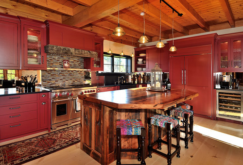 modern kitchen with red cabinets