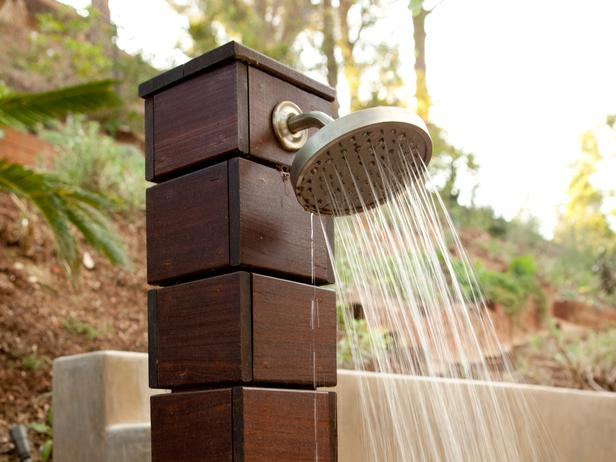 modern outdoor shower head spraying