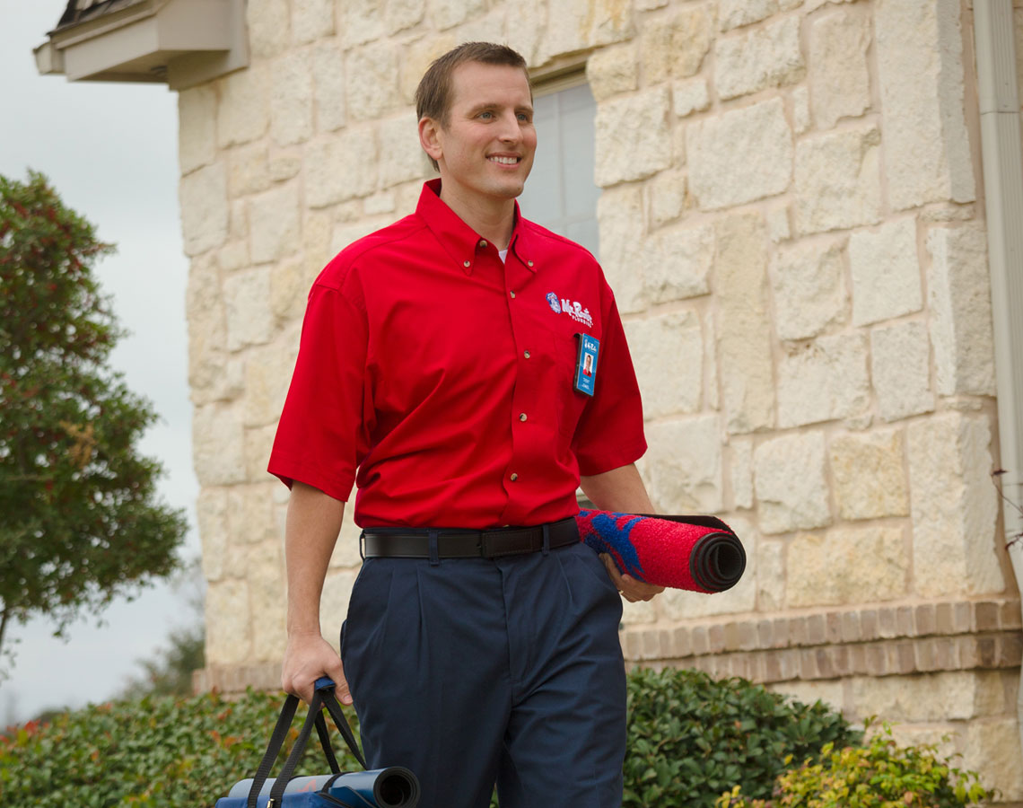 Mr. Rooter Plumber Headed to work with his mat and uniform