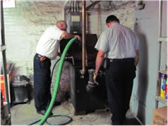 Plumbers Cleaning a Grease Trap
