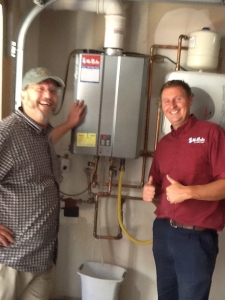 plumber with happy customer