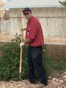 Mr. Rooter plumber using a rake