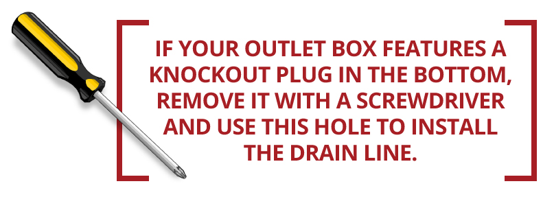If your outlet box features a knockout plug in the bottom, remove it with a screwdriver.