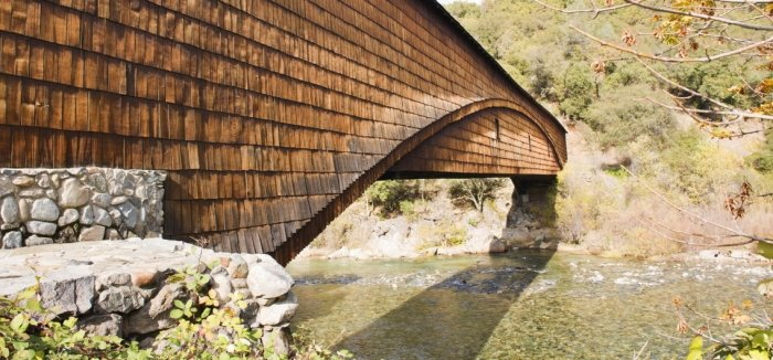 shingled bridge over river