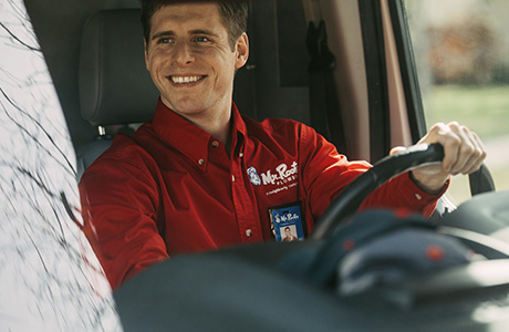 Mr. Rooter Plumber driving a van