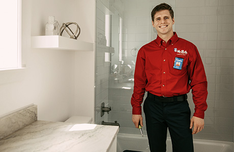 Mr. Rooter Plumber in a bathroom