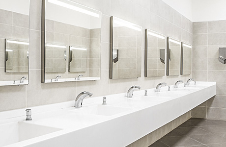 commercial bathroom with sinks and mirrors