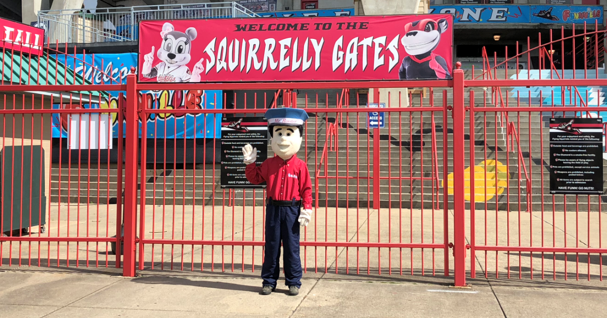 rooter mascot in front of gate