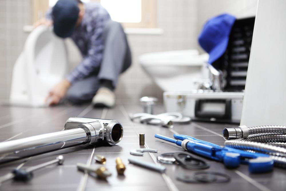 Plumber Replacing Toilet